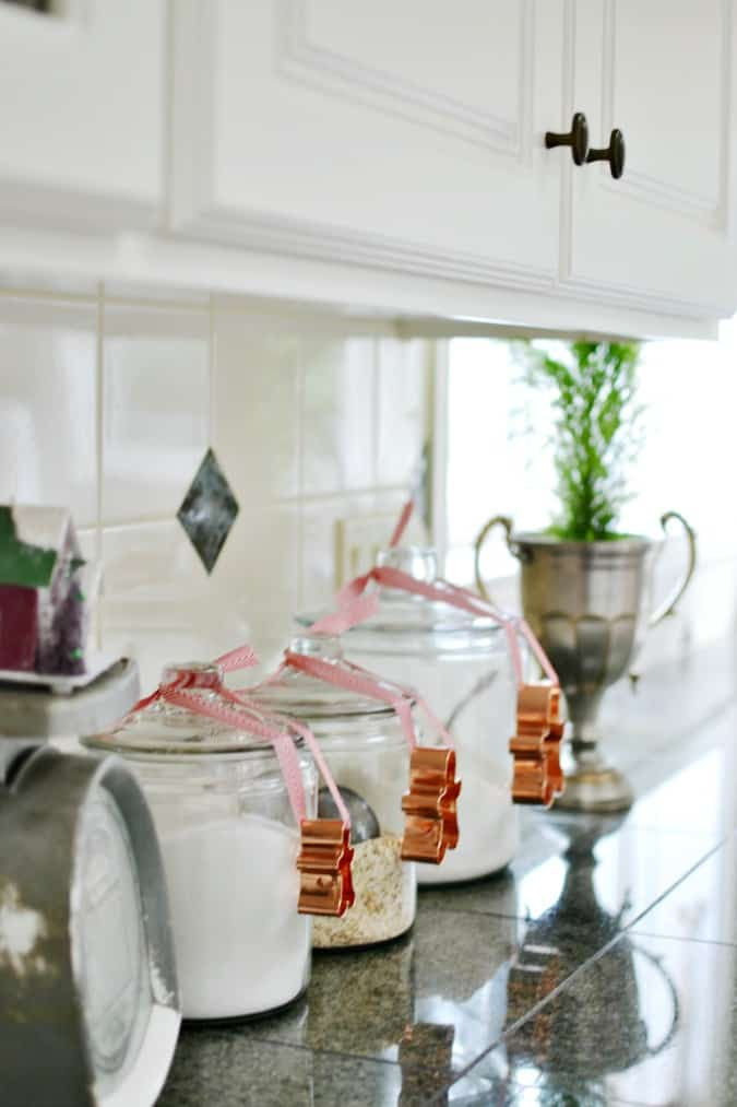 gingerbread-men-cookie-cutters-tied-to-canisters-in-christmas-kitchen