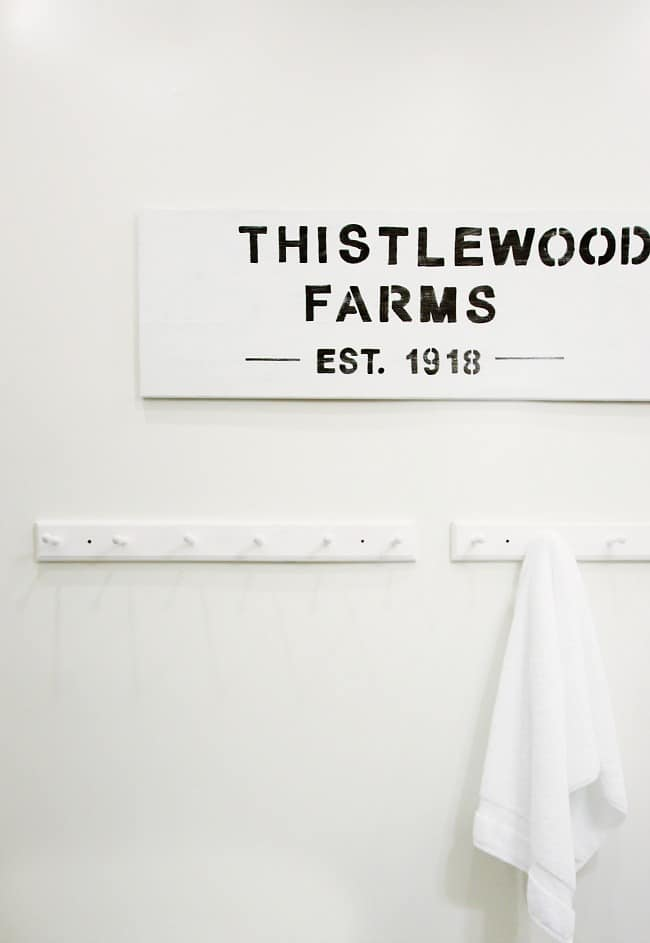 This painted thistlewood farms wood sign looks great in the bathroom.