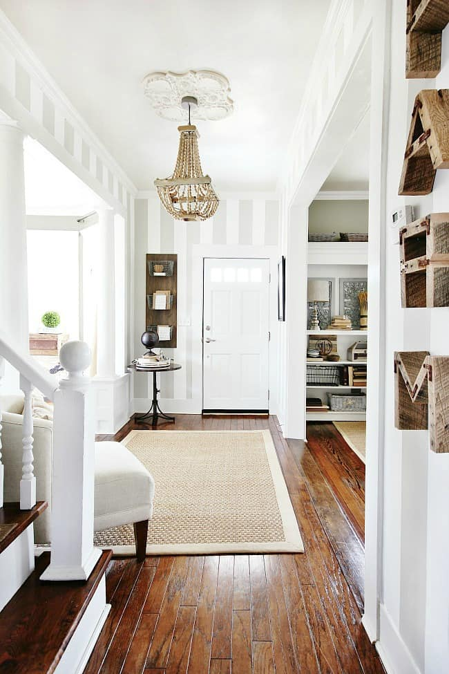 This lovely entryway is chic decorated with re-purposed wall accents found on the side of the road.