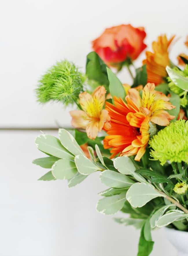 Add some accent flowers with a pop of color to spice things up.