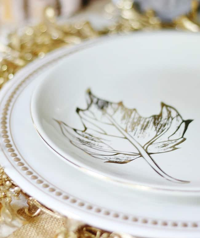 These festive plates with a gold painted leave and gold dots are made of plastic and affordable.