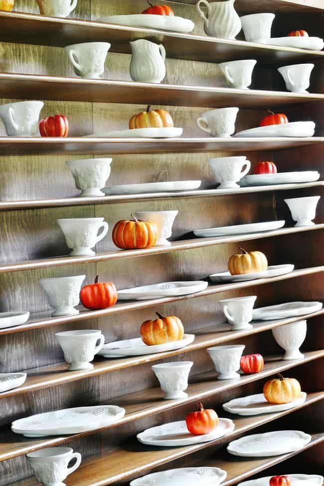 Adding mini pumpkins to the selves in your home will add a festive pop to your decor.
