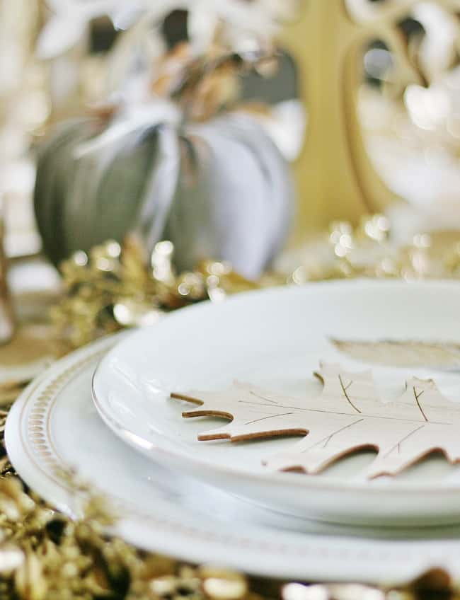 These small wooden leaf cut-out decorations add a festive touch to dinner plates.