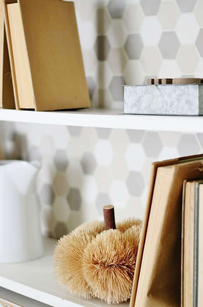 A close up look at the tiled bookcase.