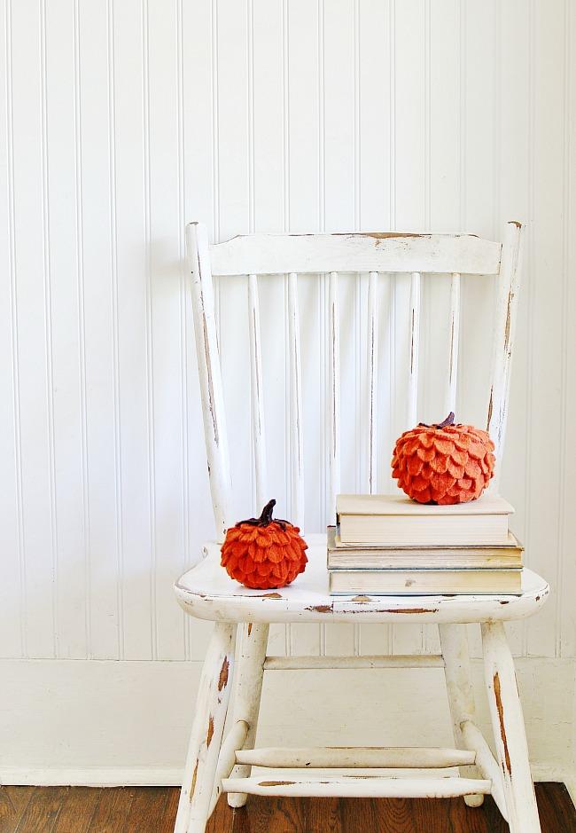 DIY felted wool pumpkin on chair