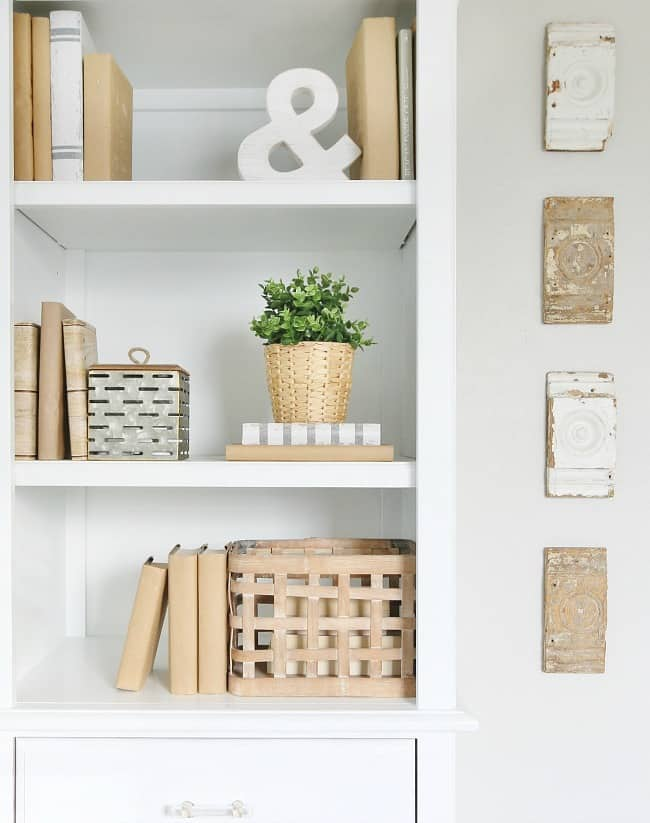 Farmhouse style bookshelf and decorations; books, potted plant and wooden crate