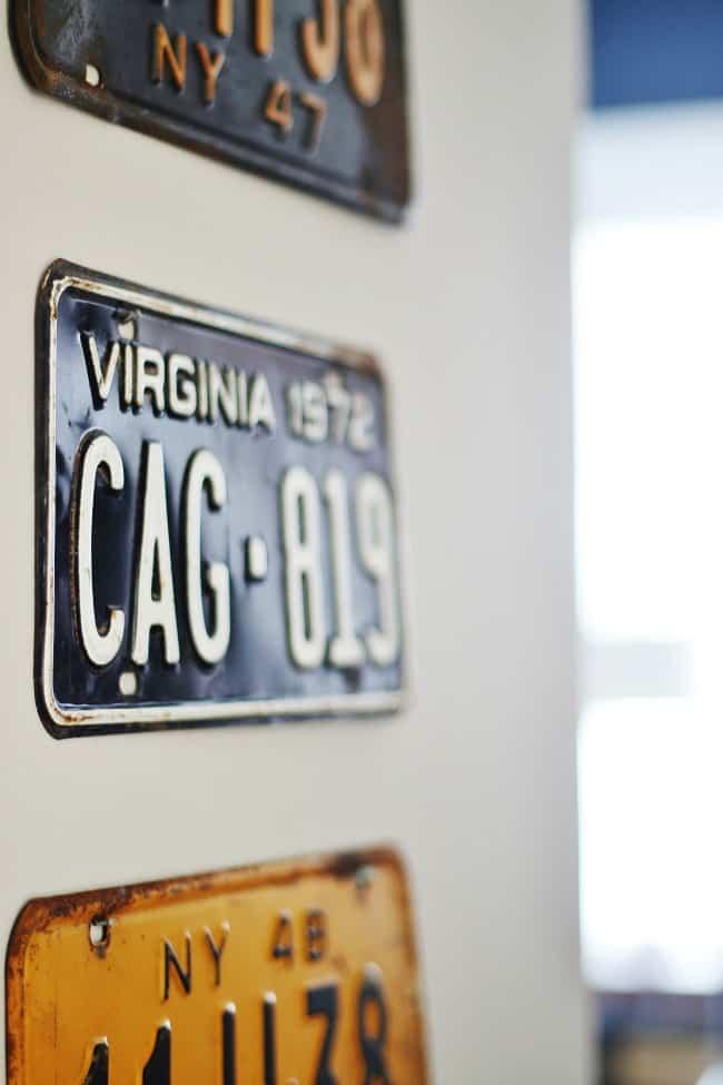 Vintage plates displayed in the bedroom