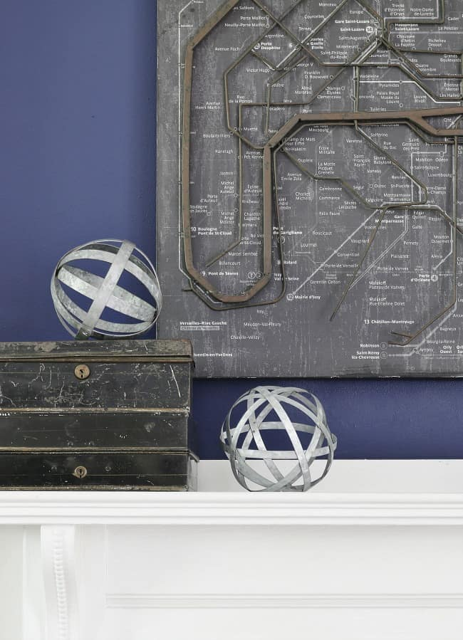 These vintage decorations look great styled on the new white wood mantle, complimenting the rich indigo blue wall color