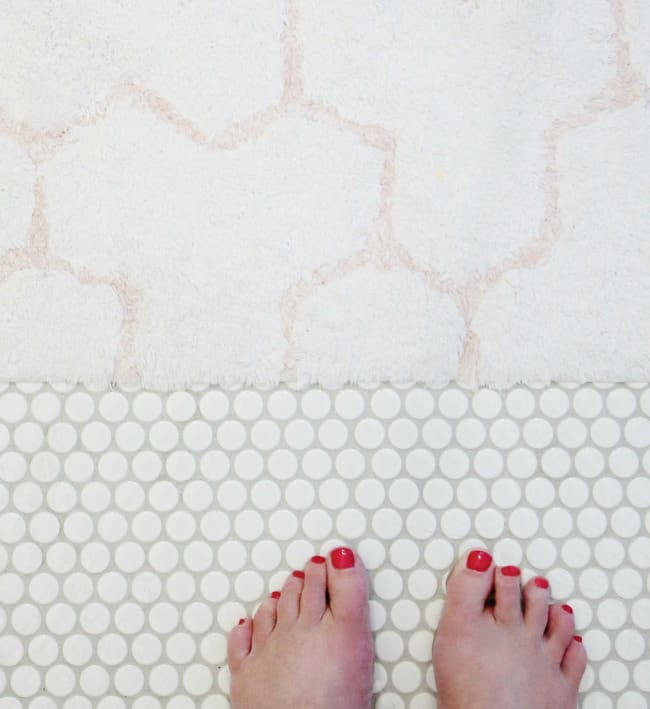 This subtle pink and white bathmat works well with the new floor tile.