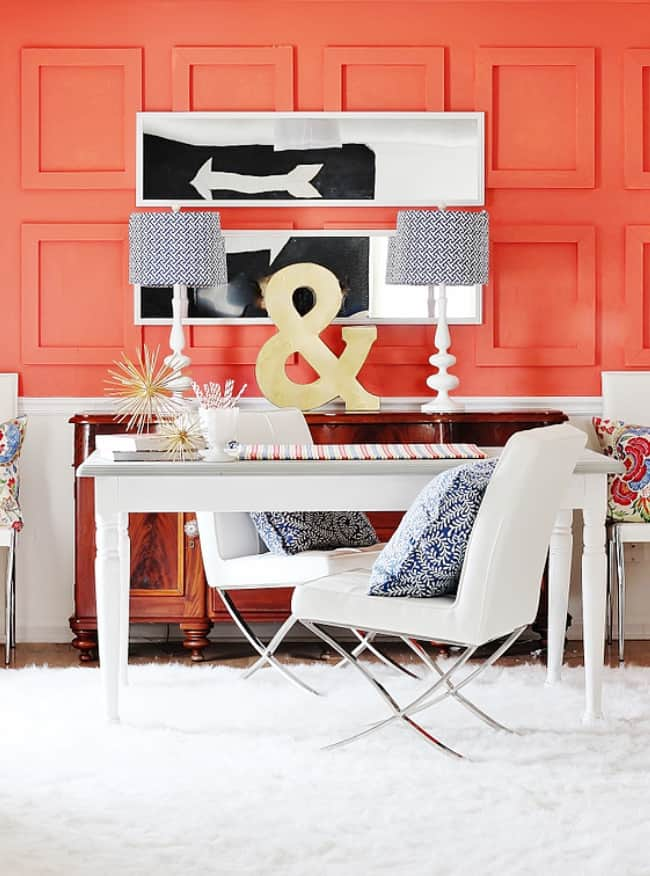 raised panel coral wall with white furniture wood console mirrors
