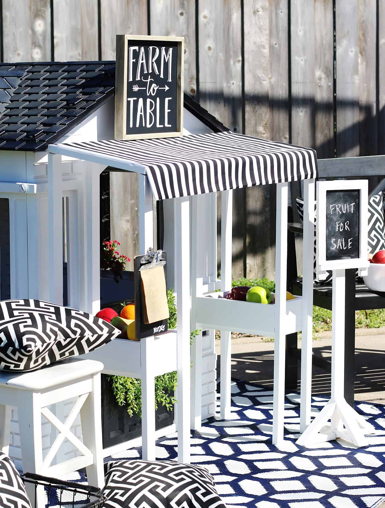 diy playhouse with black and white accessories