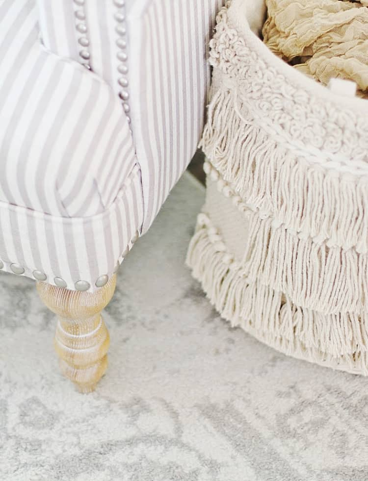 woven basket and striped chair and summer decorating ideas for the living room