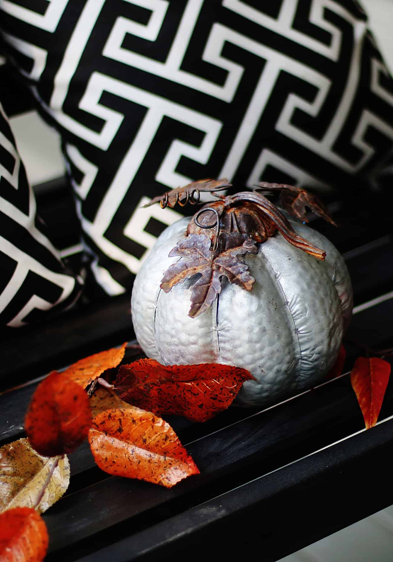 fall porch decorating ideas metal pumpkins