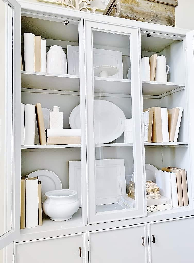 layering in books when decorating with thrift store finds
