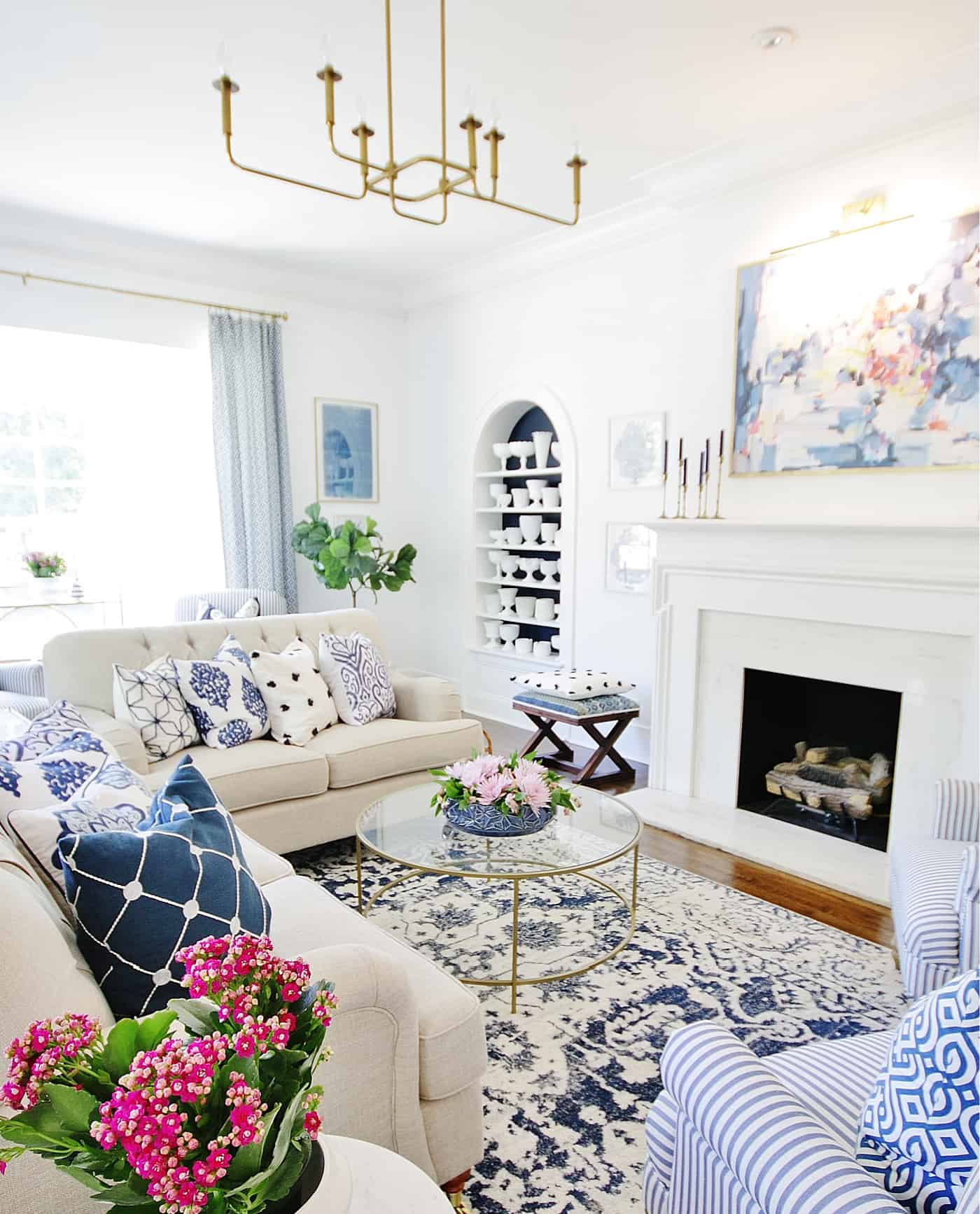 blue and white living room how to mix patterns in space
