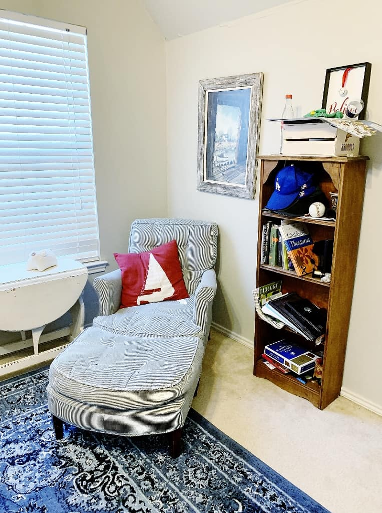 chair and bookcase in corner of room